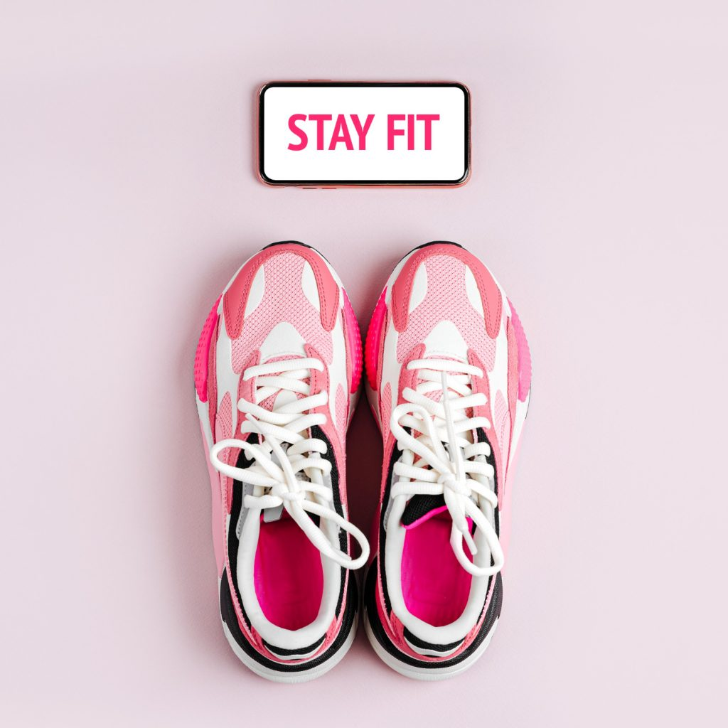 stay-fit-new-sneakers-smartphone-pink-background-app-training-indoors